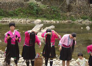 Yao women washing their longest hair in the world